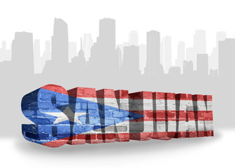 text san juan with national flag of puerto rico near abstract silhouette of the city