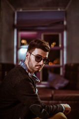 Young stylish sexy handsome model man in casual cloth lifestyle in glasses.