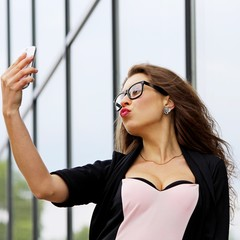 Attractive young woman doing a selfe.