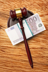 Wooden judge's gavel and money