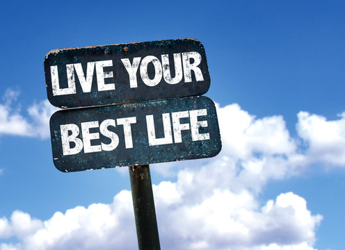 Live Your Best Life sign with sky background