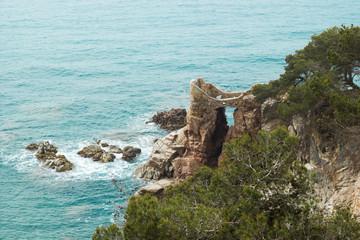 Sea rocks and waves