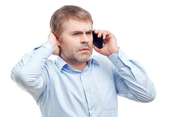 Concentrated man talking on phone