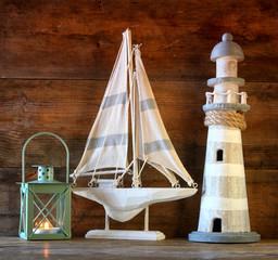 nautical lifestyle concept. old vintage lighthouse, sailing boat , lantern