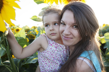 mother and daughter in sunflowers