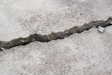 cracked concrete cement sidewalk foundation