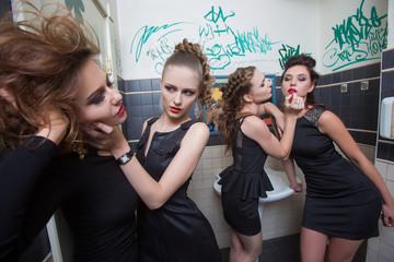 drunk girl in toilet bars. women in evening dresses in alcoholic
