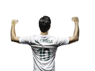 Algerian soccer player celebrates on white background