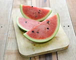 Slice Fresh Watermelon on wood background