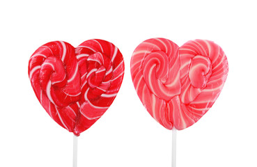 Two heart shaped lollipops isolated on white