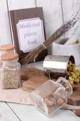 Dried herbs with nutmeg on table close up