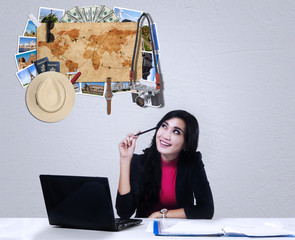 Female worker thinking famous places to vacation