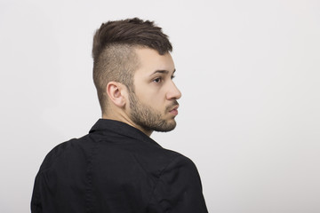 Guy with mohawk, side profile.
