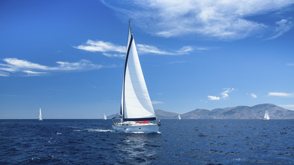 Sailing boats with white sails in the Sea. Luxury ship yachts...