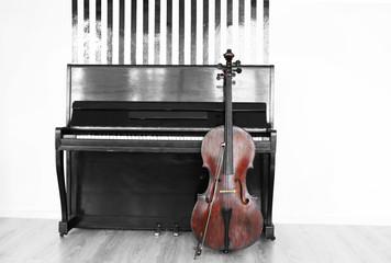 Cello near piano, indoors