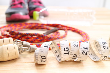 fitness equipment isolated on wood  background