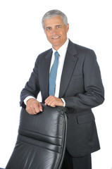 Businessman Standing Behind His Chair