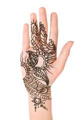 Image of henna on female hand isolated on white
