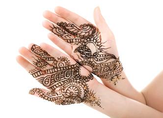 Image of henna on female hands isolated on white