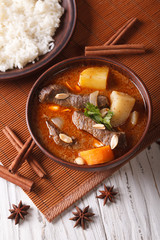 traditional Thai beef massaman curry close-up. vertical top view