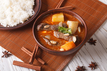 Thai beef massaman curry with peanuts and rice side dish