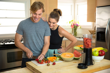 Paleo diet fruits nuts and veggies vegan lifestyle couple share a healthy nutritional lunch snack smoothie