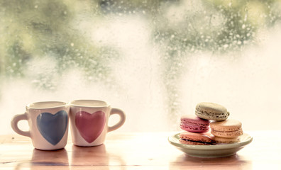 macaroon with lovely glass on rainy day window background  in sw