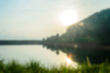 blurry landscape with lake at sunrise