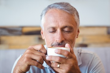 Man sitting in cafe having coffee
