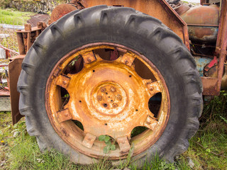 Old derelict tractor wheel and tyre, Salen Pier, Isle of Mull, Scotland