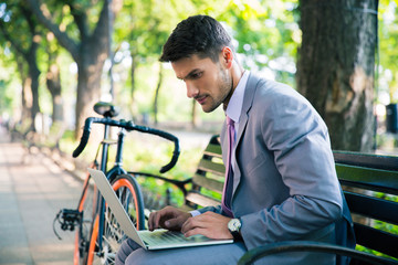 Handsome businessman using laptop