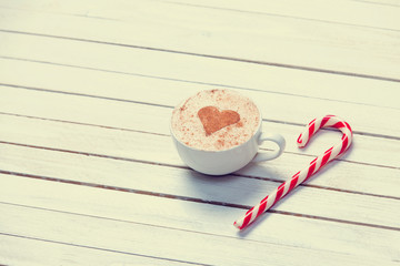 Cup of coffee and christmas candy
