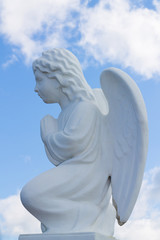 Tranquil Scene of statue of  angel child at the blurred background.