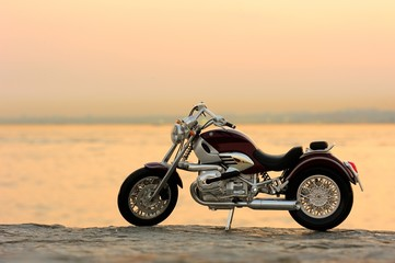 Motorcycle on the rocks in sunset and golden hours