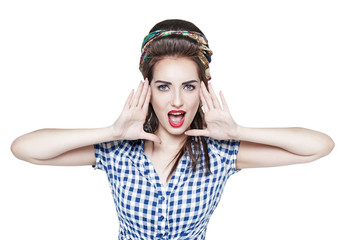Young beautiful woman in retro pin up style shouting with her ha