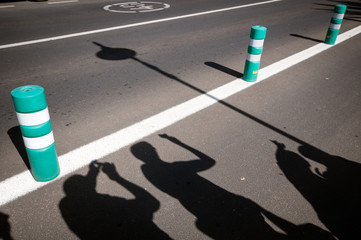 shadows of people on the road