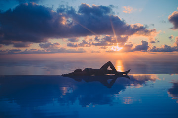 Relaxing at infinity pool Wall mural