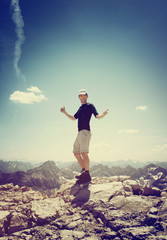Happy Male Hiker doing Thumbs up on a Summit