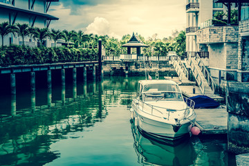 White speed boat at the pier, Vintage style photograph