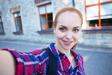 beautiful student or school girl making selfie photo