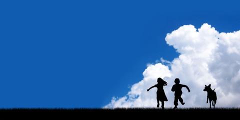 children and dog running on blue sky background.