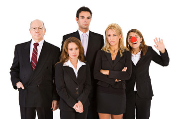 Business: Woman With Clown Nose Having Fun With Serious Team