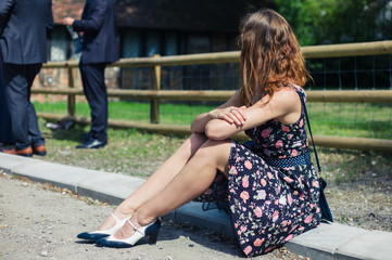 Young woman sitting outside at party