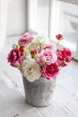 beautiful and delicate bouquet of buttercups in a zinc vase