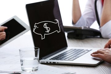 Money concept. Business people working with laptop at wooden table, closeup