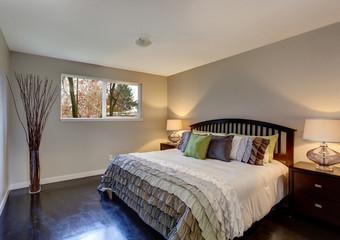 Perfect hardwood bedroom with ruffled bedding.
