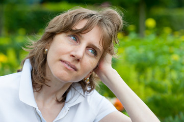 Middle age woman thinking