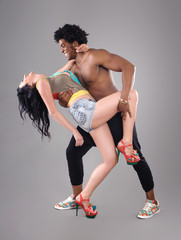 Passionate couple / Young and sexy passionate couple on gray studio background