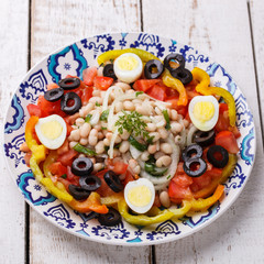 Salad with white beans and fresh vegetables,olives and egg, Turkish cuisine.selective focus