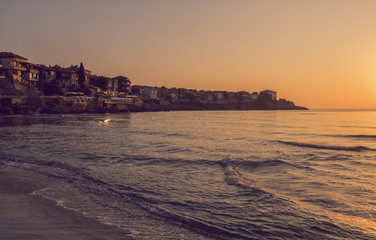 Vintage toned picture of sunrise in Sozopol, Bulgaria